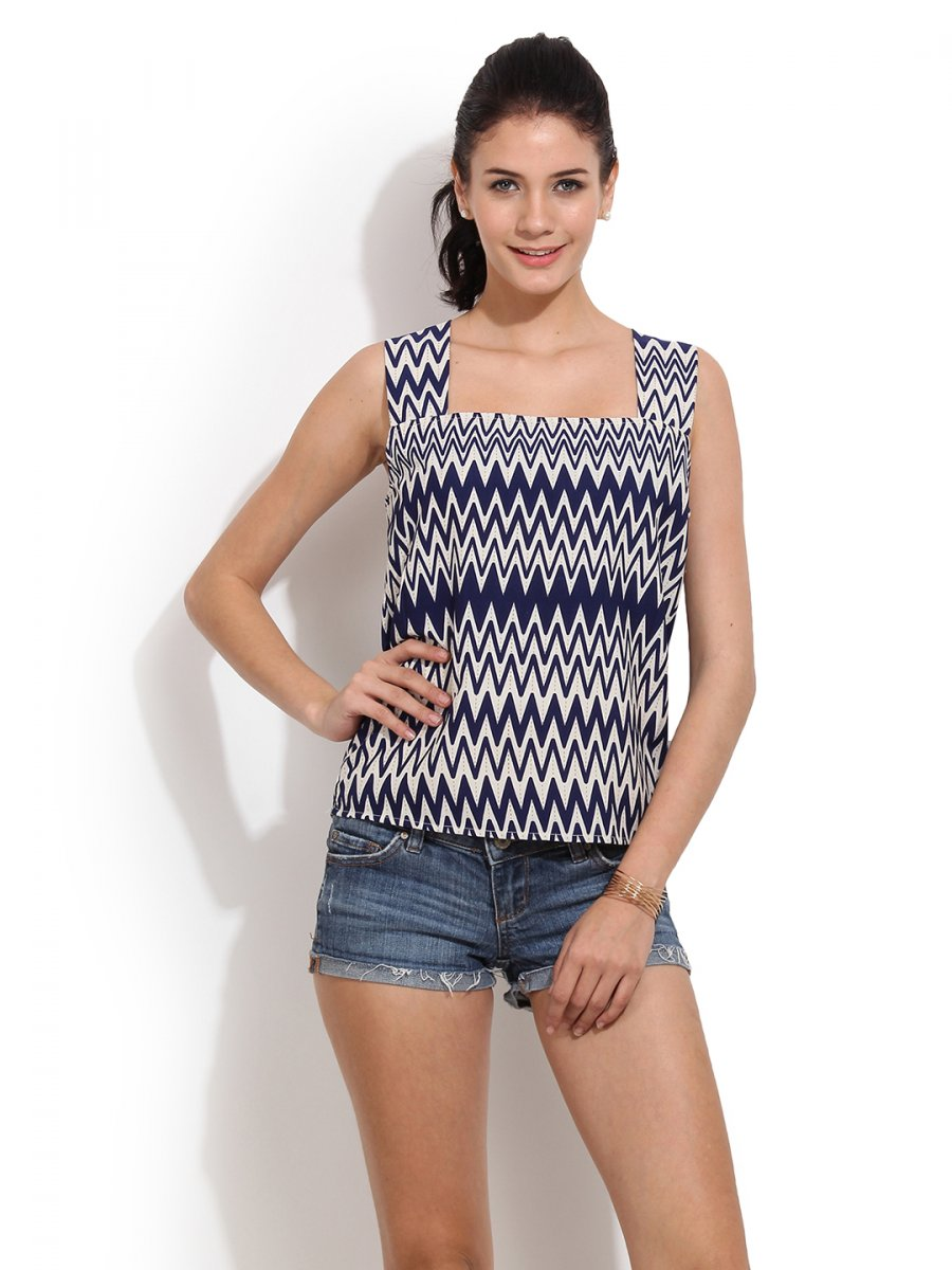 2. White capris, blue knitted top