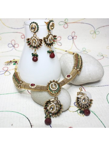 https://static8.cilory.com/30691-thickbox_default/elegant-polki-work-necklace-set-carved-with-stone-and-beads.jpg